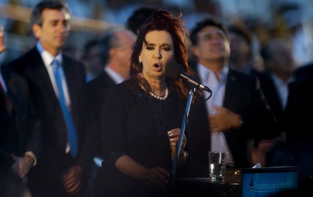 Description of . Argentina's President Cristina Fernandez delivers a speech during a welcoming ceremony to celebrate to celebrate the return of the ARA Libertad at Mar del Plata port, Argentina, Wednesday, Jan. 9, 2013. The Argentine naval ship detained for more than two months in Ghana because of a financial dispute returned home to a triumphant welcome.  Fernandez has called the Libertad a symbol of Argentina's sovereignty and has hailed its return as a victory for the country.  (AP Photo/Natacha Pisarenko)