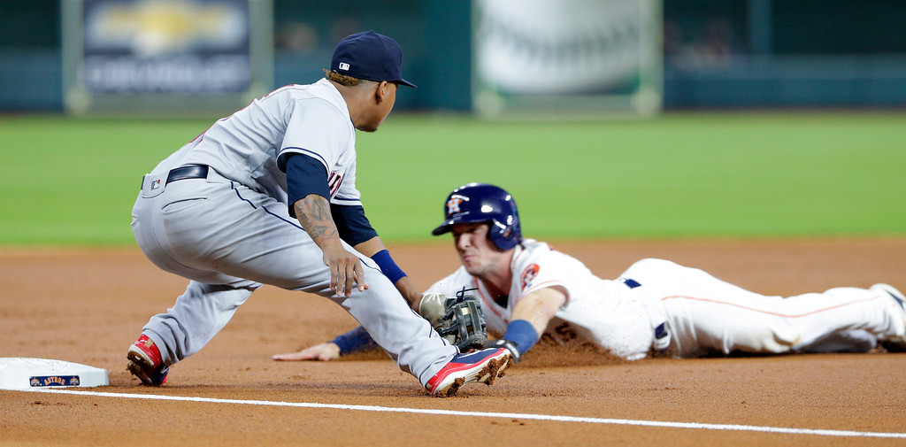 . Cleveland Indians third baseman Jose Ramirez makes the tag on Houston Astros Alex Bregman during the first inning of a baseball game Sunday, May 20, 2018, in Houston. (AP Photo/Michael Wyke)