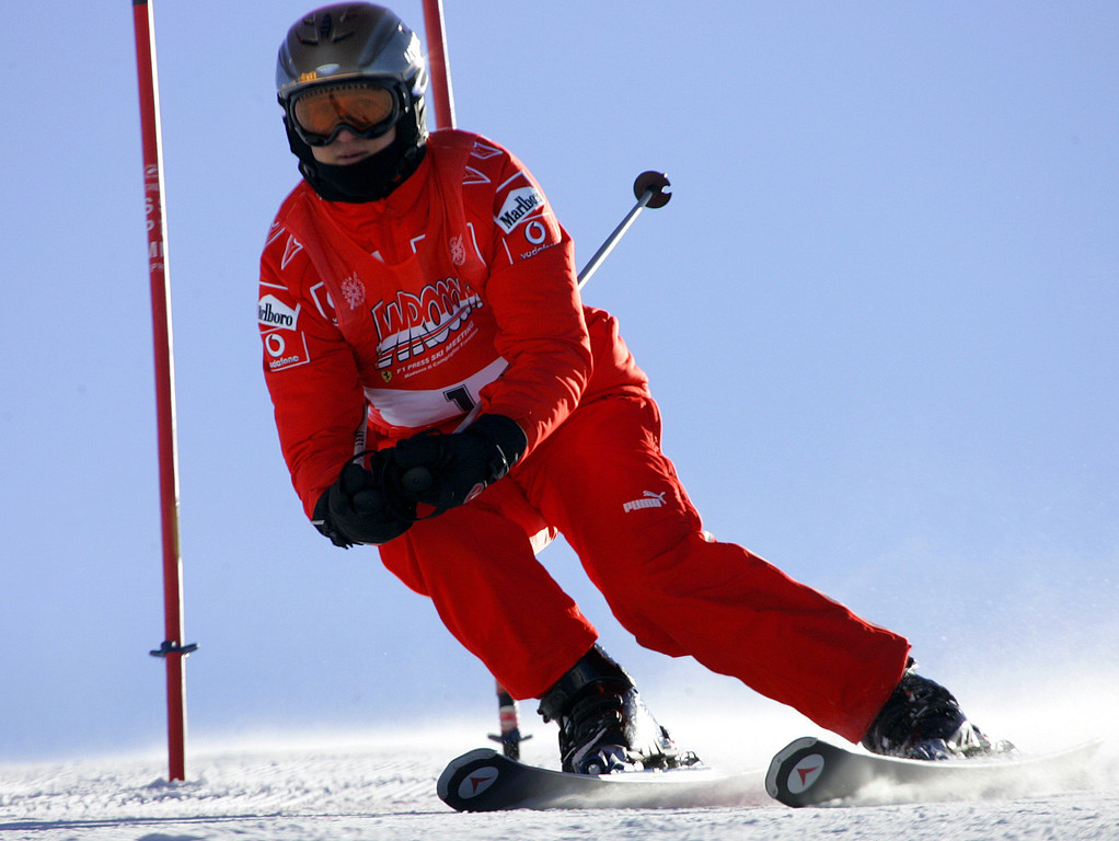 . FILE - In this Friday, Jan. 13, 2006 file photo, Ferrari driver Michael Schumacher of Germany speeds down a course in Madonna di Campiglio, Italy. Schumacher is in this Italian Alps ski resort for the yearly meeting between Ferrari drivers and the press.  French radio says retired Formula One champion Michael Schumacher has been injured in a skiing accident.  RMC radio reported Sunday Dec. 29, 2013 that the seven-time champion had fallen while skiing off-piste at the French Alpine resort of Meribel.  The radio quoted resort director Christophe Gernigon-Lecomte as saying that Schumacher was wearing a helmet when he fell and hit a rock. (AP Photo/Luca Bruno, File)