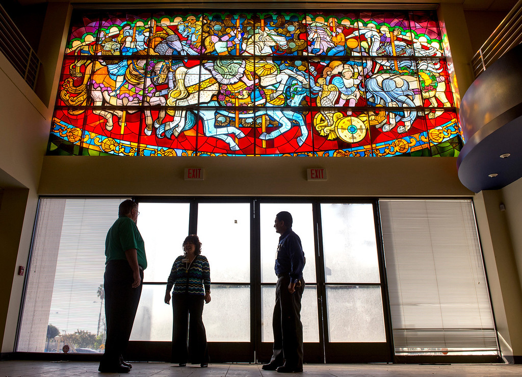 """. PIH Health has purchased the former Montebello, Calif. Home Savings and Loan to use as an urgent care facility.  Two historic items, a stained glass window, �The Carousel�, pictured, designed by Susan Hertel and fabricated by John Wallis and Associates on the south façade, and a mosaic mural, \""""A Day in the Country\"""", designed by Millard Sheets and executed by Nancy Colbath on the building�s north façade will be preserved by PIH at the Beverly Boulevard location Jan. 21, 2014. (Staff photo by Leo Jarzomb/Whittier Daily News)"""