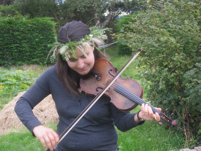 Autumn playing her violin