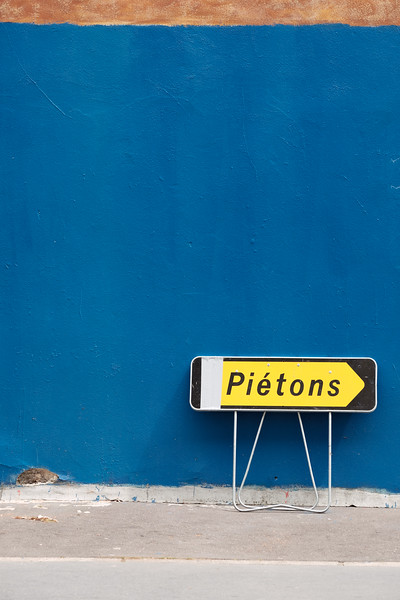 Street sign on a blue wall in Paris