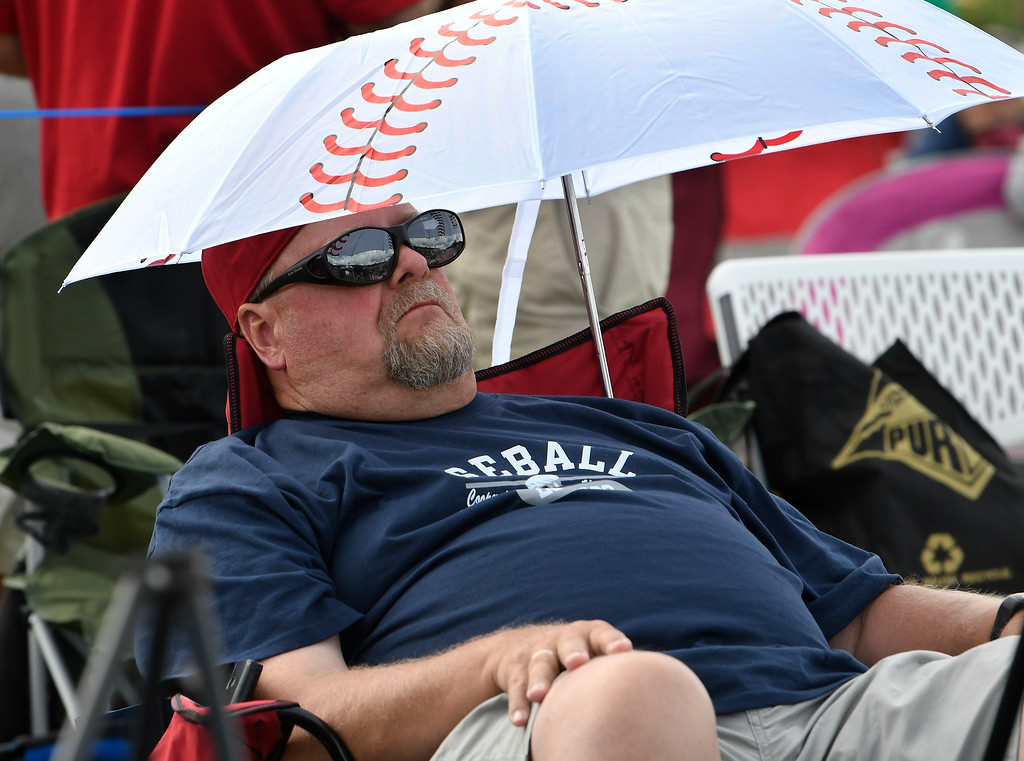 . Jack Morris fan, Mark Ostgarden, of Moorhead, Minn., waits for the start of National Baseball Hall of Fame induction ceremonies Sunday, July 29, 2018, in Cooperstown, N.Y. (AP Photo/Hans Pennink)