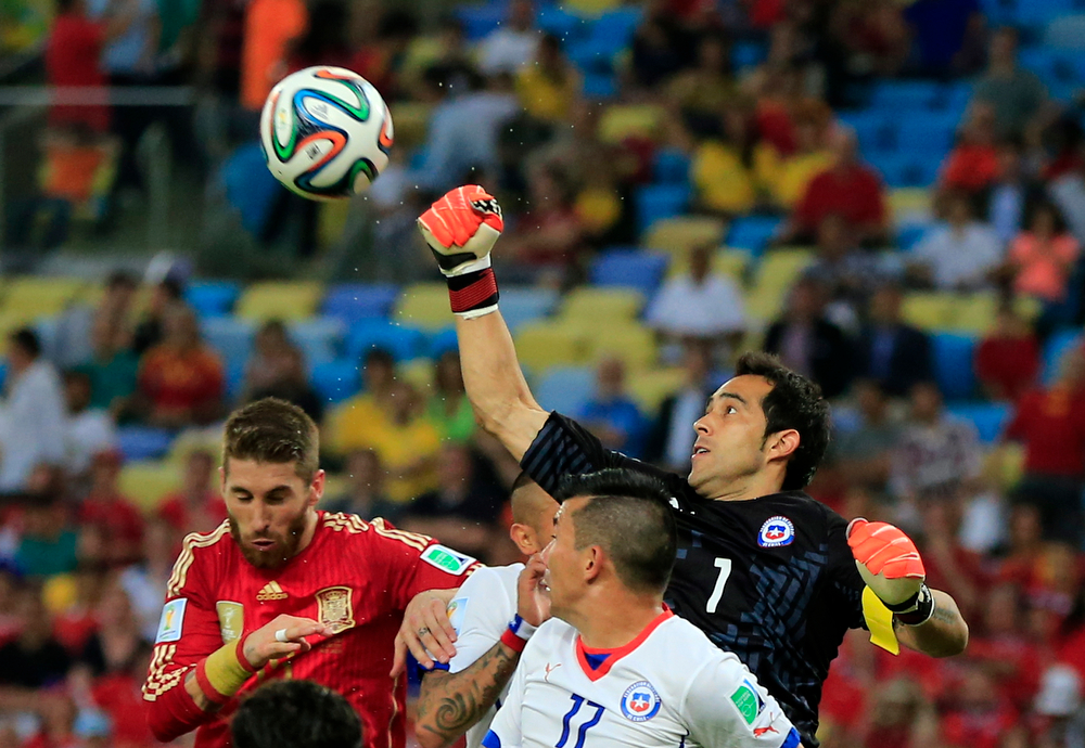 . Chile\'s goalkeeper Claudio Bravo punches the ball clear during the group B World Cup soccer match between Spain and Chile at the Maracana Stadium in Rio de Janeiro, Brazil, Wednesday, June 18, 2014.  (AP Photo/Bernat Armangue)