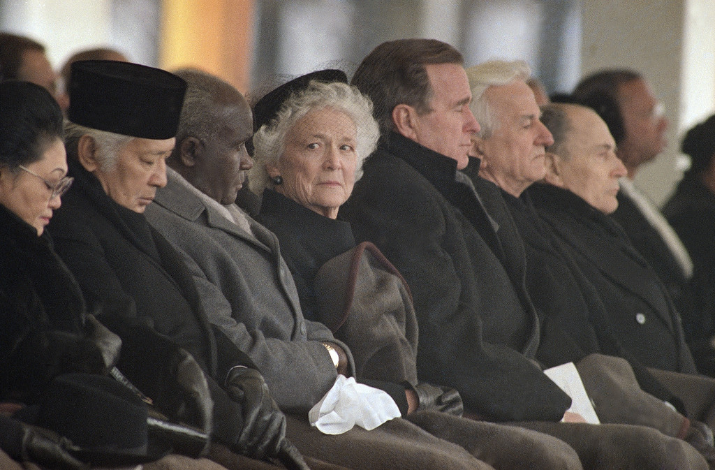 . U.S. President George H. Bush and Mrs. Barbara Bush attend the funeral of Emperor Hirohito, Friday, Feb. 24, 1989 at Shinjuku Imperial Garden in Tokyo with other world leaders. From left are Indonesian President and Mrs. Suharto, Zambian President Kenneth Kaunda, Mrs. Bush, President Bush, West German President Richard von Weizsaecker, and French President Francois Mitterrand. (AP Photo/Sadayuki Mikami)