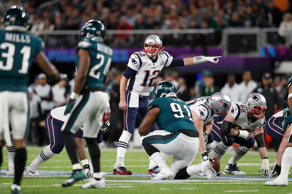 . New England Patriots\' Tom Brady signals during the first half of the NFL Super Bowl 52 football game against the Philadelphia Eagles Sunday, Feb. 4, 2018, in Minneapolis. (AP Photo/Jeff Roberson)