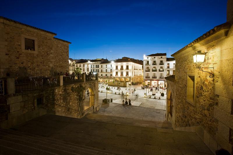 Plaza Mayor at dusk, as seen from Arco de la Estrella, Caceres, Spain