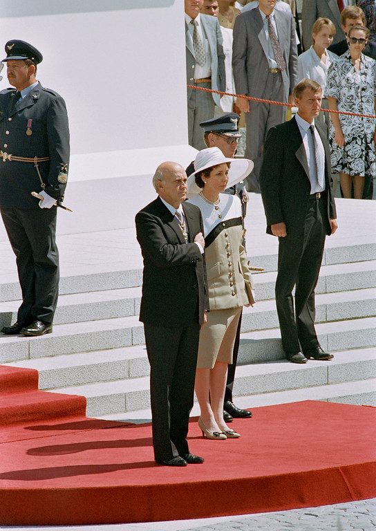 . South African State President F.W. de Klerk and his wife, Marike de Klerk, stand to attention during the opening of parliament in Cape Town, South Africa, Friday, Feb. 2, 1990. De Klerk announced the unbanning of the ANC and all other political parties, the lifting of the state of emergency and the unconditional release of Nelson Mandela. (AP Photo/Adil Bradlow)