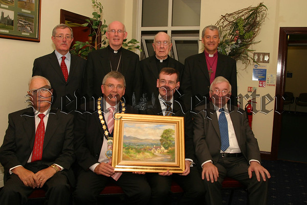 Civi Reception for his Excellency, Mr Francis Campbell, Mayor Michael Carr presents Francis with a beautiful painting, Back l-r Tom Mc Caul (chief excutive n&m council),Archbishop Sean Brady, Canon Pat Mc Anuff, The RT.Rev Michael Jackson.  front l-r Eddie Mc Grady, (SDLP), Mayor Michael Carr, His Excellency Mr Francis Campbell, and Francis's Father  Mr Daniel Campbell. 06W31N52