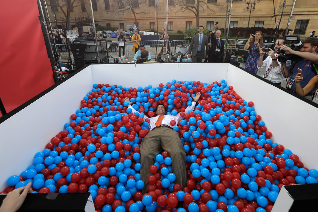 . Clemson coach Dabo Swinney falls into a ball pit before the first round of the 2017 NFL football draft, Thursday, April 27, 2017, in Philadelphia. (AP Photo/Julio Cortez)