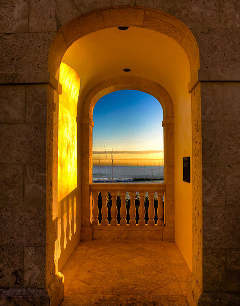 The golden light of sunrise on the clock tower archway.