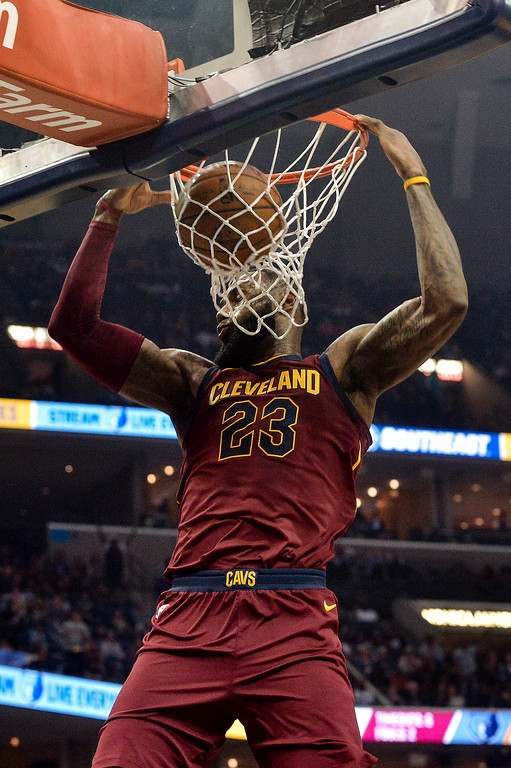 . Cleveland Cavaliers forward LeBron James (23) dunks the ball in the first half of an NBA basketball game against the Memphis Grizzlies Friday, Feb. 23, 2018, in Memphis, Tenn. (AP Photo/Brandon Dill)
