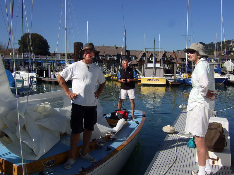 "Marc Lambros, son and lady friend of Ron Young - Sailing on San Francisco Bay on Ron Young's classic wooden boat ""Youngster"""
