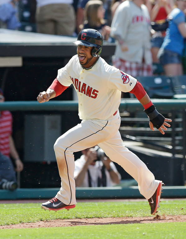 . Cleveland Indians\' Mike Aviles scores on a game-winning two-run home run hit by Michael Bourn in the ninth inning of a baseball game against the Colorado Rockies, Sunday, June 1, 2014, in Cleveland. The Indians defeated the Rockies 6-4. (AP Photo/Tony Dejak)