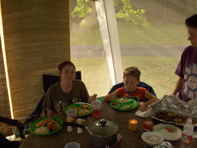 Tammy camping eating 5-27-05.JPG
