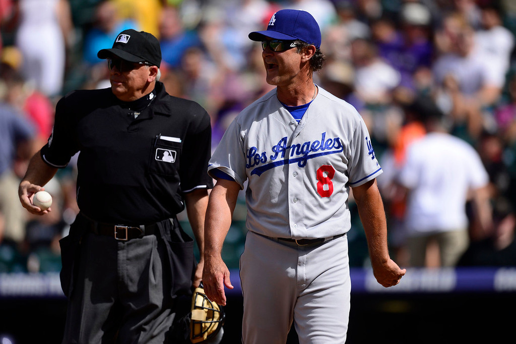 . Don Mattingly (8) of the Los Angeles Dodgers argues a call with umpire Larry Vanover (27) during the action in Denver on Monday, September 2, 2013. The Colorado Rockies hosted the Los Angeles Dodgers at Coors Field.   (Photo by AAron Ontiveroz/The Denver Post)