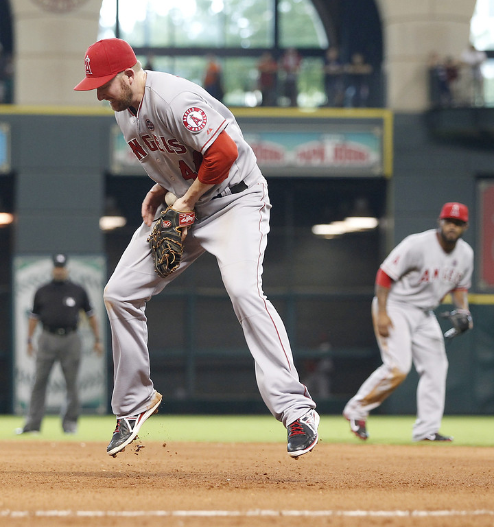 . HOUSTON, TX- SEPTEMBER 15: Mark Trumbo #44 of the Los Angeles Angels of Anaheim fields a hard grounder hit by Marc Krauss #59 of the Houston Astros in the seventh inning on September 15, 2013 at Minute Maid Park in Houston, Texas. (Photo by Thomas B. Shea/Getty Images)