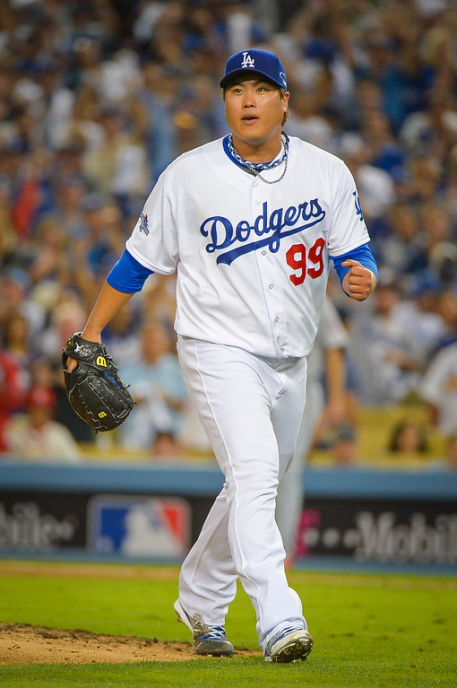. Dodgers\' Hyun-Jin Ryu retires the side in NLCS game 3 at Dodger stadium Monday, October 14, 2013 ( Photo by Andy Holzman/Los Angeles Daily News )