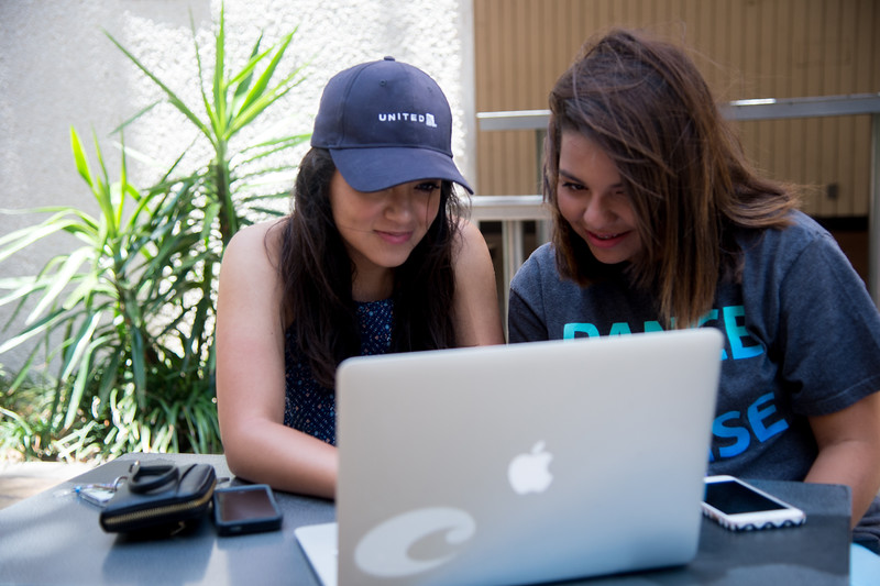 Kaitlyn Vargas(left) and Mykaylah Garcia enjoy technology in the great outdoors.
