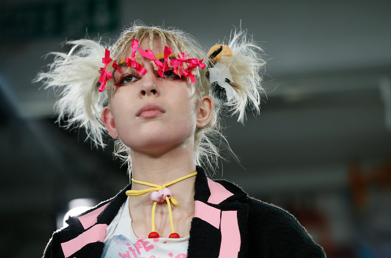 . A model wears an outfit by designers Meadham Kirchhoff during their Spring/Summer 2015 show at London Fashion Week in London, Tuesday, Sept. 16, 2014. (AP Photo/Alastair Grant)