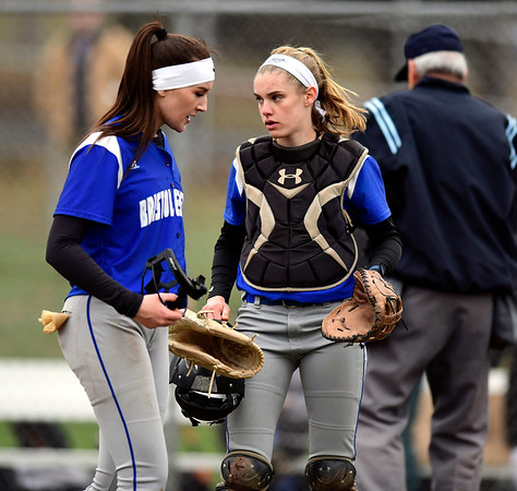 4/9/2019 Mike Orazzi | Staff Bristol Eastern's Erin Girard (13) and Paige McLaughlin (2) during Tuesday's softball game with Southington in Bristol.