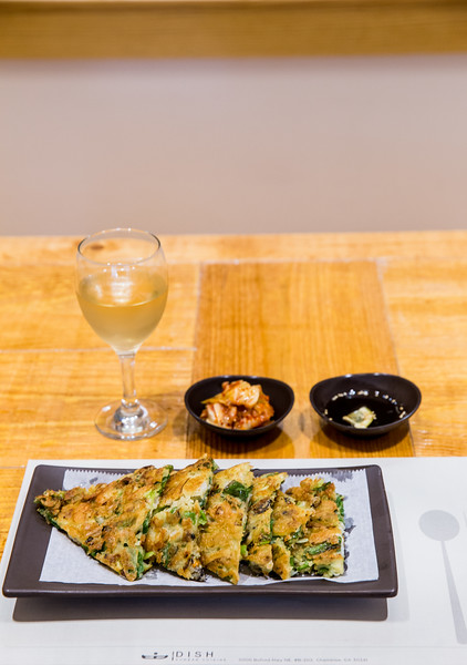 Dish Korean Restaurant on Buford Highway has an appetizer Paemul Pajeon or seafood Korean pancake made with shrimp, mussels, clams and octopus in a wheat flour batter with green onions.  The pancakes are serves with house made  soy and kimchi. (Jenni Girtman / Atlanta Event Photography)