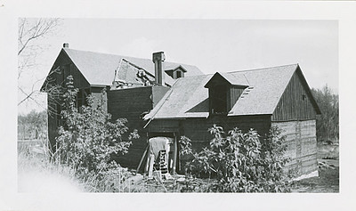 """Linfred noted that at one time, there were three flour mills in Spearfish.  This 1939 photograph shows the """"south side of Spearfish flour mill.  The old tramway took the wheat in an open door at top wheat bin.  Sacks of wheat were unloaded from wagons into a small car holding 15 sacks and pushed into top of bin and wheat was then unloaded.""""  A veryslow proces.  Photo and information is courtesy of the South Dakota State HIstorical Society."""