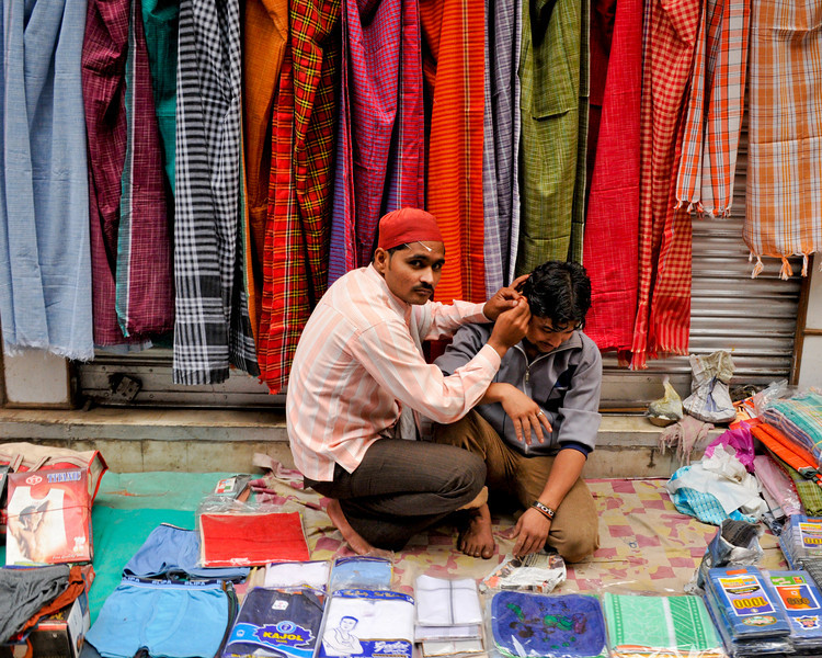 A street acupuncturist. Also sells saris and other wares.