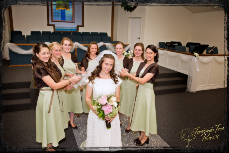 Photo of Chelsea the bride at her wedding and all her bridesmaids at our church in Temecula