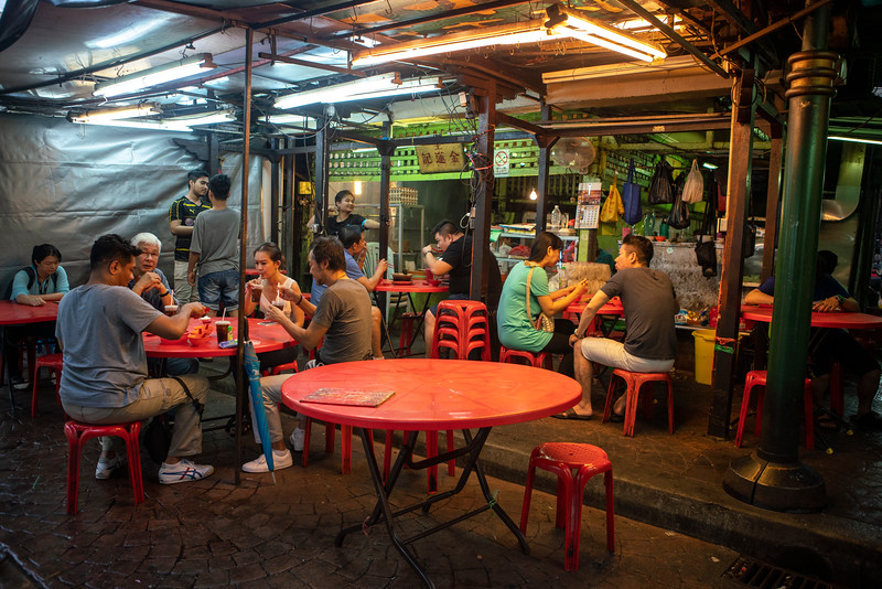 Locals gather at a popular noodle and soup restaurant in Kuala Lumpur's Chinatown. The food scene in KL is currently exploding and spectacular Chinese, Malay, and Indian dishes can be found in small informal restaurants like this throughout the city.