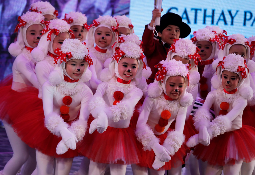 . Performers take part in a night parade to celebrate Chinese New Year in Hong Kong, Friday, Feb. 16, 2018. The Lunar New Year this year marks the Year of the Dog in the Chinese calendar. (AP Photo/Vincent Yu)