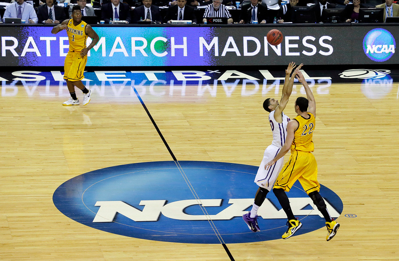 . Wyoming\'s Larry Nance Jr., right, passes over Northern Iowa\'s Jeremy Morgan, second from right, during the second half of an NCAA tournament college basketball game in the Round of 64 in Seattle, Friday, March 20, 2015. Northern Iowa beat Wyoming 71-54. (AP Photo/Ted S. Warren)