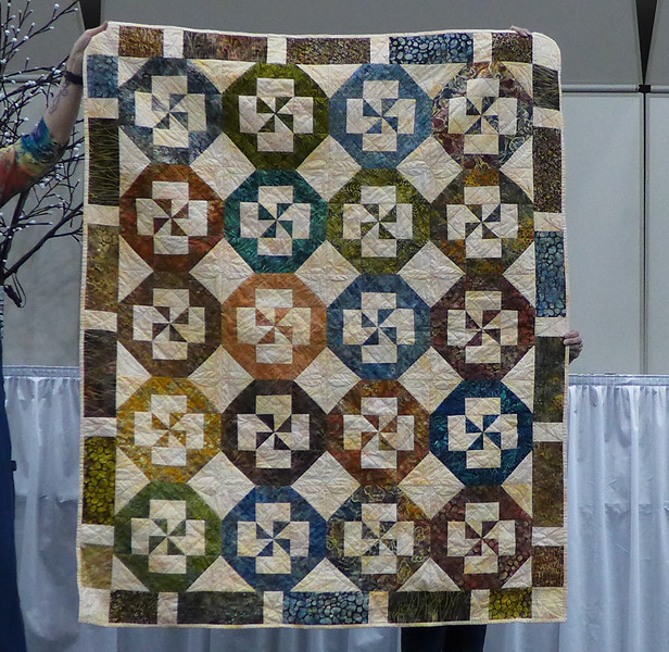 Bonnie Buss attended the Sun Bonnet Sue's retreat and Jan Gagliano and She organized a donation quilt.  Members attending made a block using the Disappearing Pinwheel pattern.