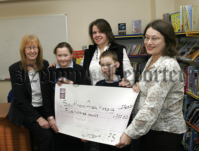 Windsor Hill PS Pupils present £500 to the Southern Area Hospice, LtoR. Heather Irvine (Principle),Zara Davis, Ruth Henning,(Parents Association),Toby  Girvan, Joanne Lindsay, (SAH). 07W6N22