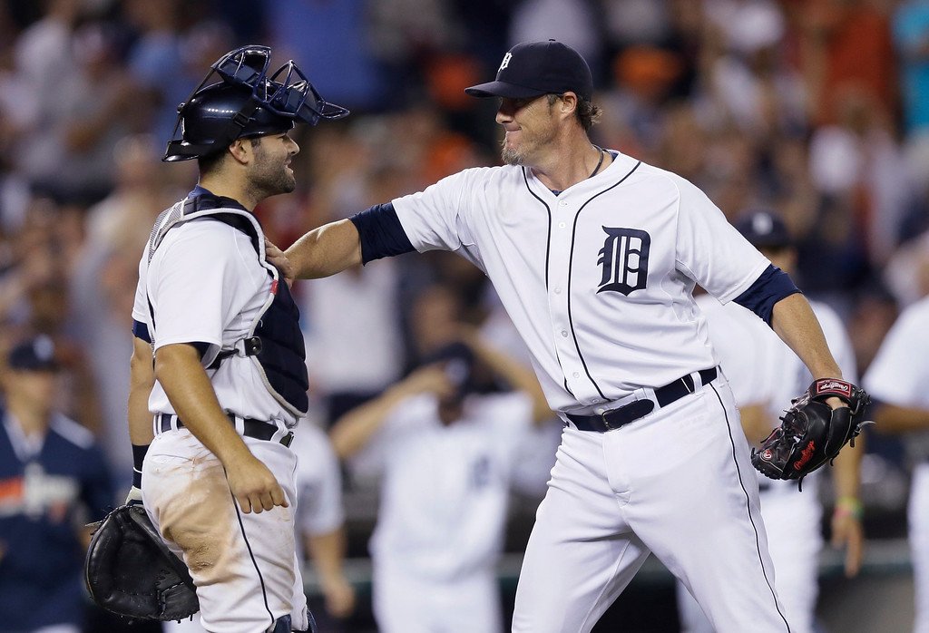 . Detroit Tigers relief pitcher Joe Nathan, right, celebrates with catcher Alex Avila after the Tigers\' 4-2 win over the Kansas City Royals in a baseball game in Detroit, Tuesday, Sept. 9, 2014. (AP Photo/Carlos Osorio)