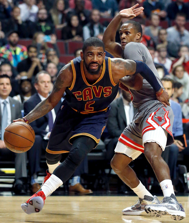 . Cleveland Cavaliers guard Kyrie Irving, left, drives to the basket against Chicago Bulls guard Rajon Rondo during the first half of an NBA basketball game Thursday, March 30, 2017, in Chicago. (AP Photo/Nam Y. Huh)