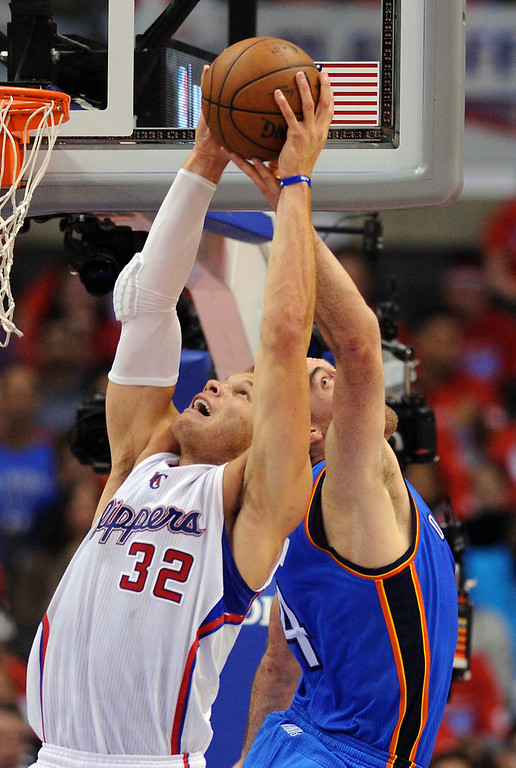 . The Clippers\' Blake Griffin out leaps the Thunder\'s Nick Collison for a rebound, Friday, May 9, 2014, at Staples Center. (Photo by Michael Owen Baker/Los Angeles Daily News)