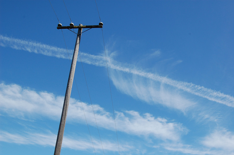 Telephone pole, interesting cloud patterns.