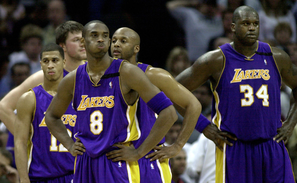 . Los Angeles Lakers guard Kobe Bryant (8) and center Shaquille O\'Neal (34) stand with teammates during a timeout in the final minutes of Game 5 of the Western Conference semifinals against the San Antonio Spurs in San Antonio, Tuesday, May 13, 2003.  San Antonio won 96-94 and lead the series 3-2. (AP Photo/Eric Gay)