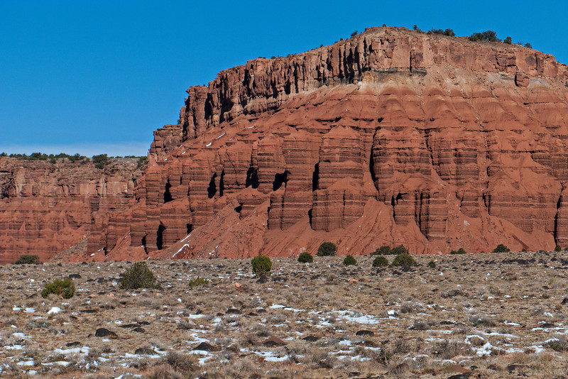 Capitol Reef National Park--Dark red Moenkopi siltstone and mudstone has formed the  Mummy Cliffs