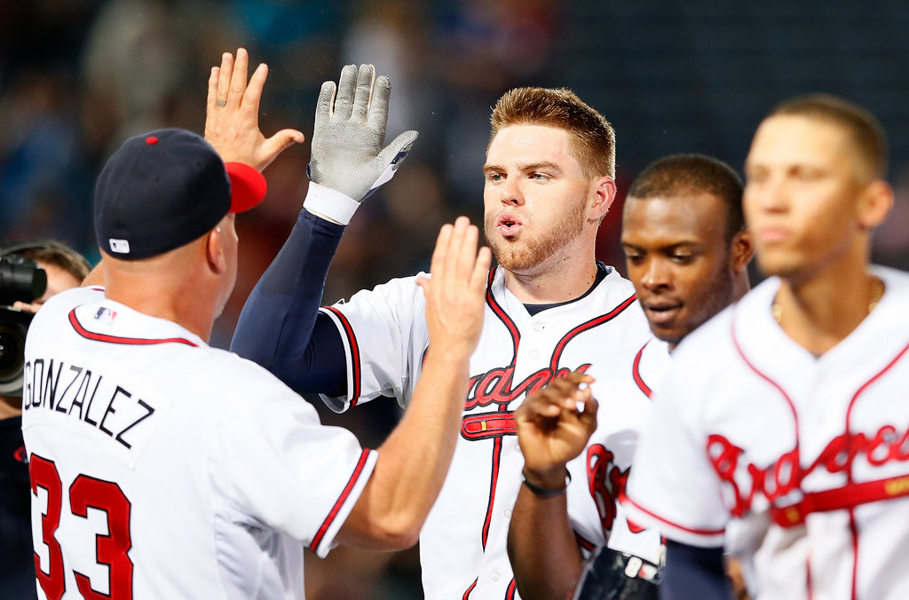 . Freddie Freeman of the Atlanta Braves celebrates with manager Fredi Gonzalez after hitting a game-winning RBI single in the bottom of the 10th inning to give the Braves a 5-4 win over the Minnesota Twins.  (Photo by Kevin C. Cox/Getty Images)