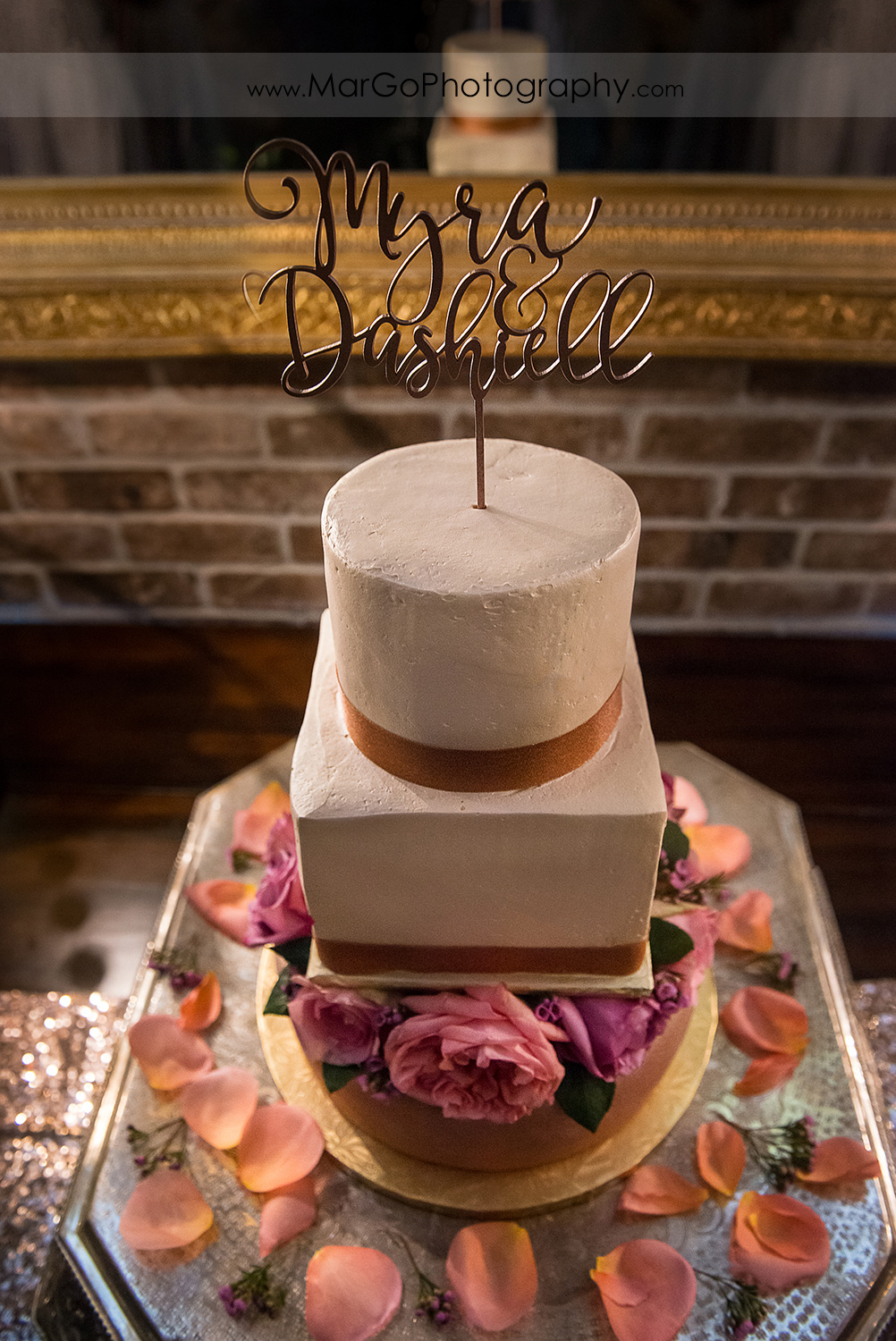 wedding cake decorated with roses at Sunol's Casa Bella