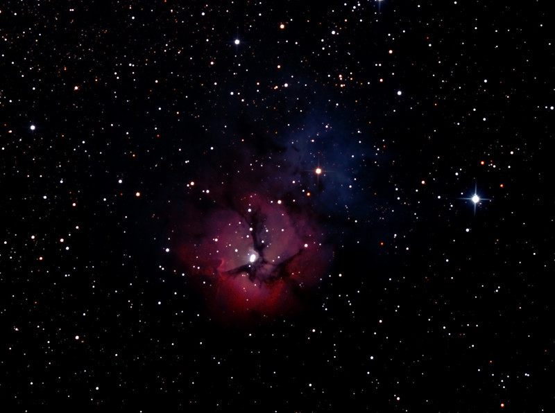 Messier M20 - NGC6514- Trifid Nebula in Sagittarius - 13/07/2012 (Processed cropped stack)  DeepSkyStacker 3.3.2 Stacked 85% of 24 Images ISO 800 120 Sec, 95 DARK, 0 BIAS, 0 FLATS, Post-processed by Photoshop CS5  I used this familiar object to compare results between 3 optical configurations - my 80mm APO refractor (22/6/2012) and borrowed Bintel 200mm f/4 (11/07/2012) and PowerNewt at native f/4 (13/7/2012).   Telescope - Jean Marie Locci's PowerNewt 200mm at f/4 with Baader MPCC Coma Corrector, Hutech LPS-P2 filter, Canon 400D DSLR, Ambient 6C. Mount - Skywatcher NEQ6 Pro. Guidescope - Orion ShortTube 80 with Star Shoot Auto Guider.