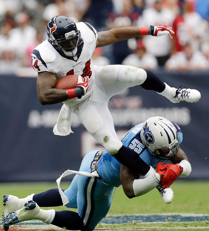 . Houston Texans\' Ben Tate (44) is stopped by Tennessee Titans\' Zach Brown (55) during the second quarter of an NFL football game on Sunday, Sept. 15, 2013, in Houston. (AP Photo/David J. Phillip)