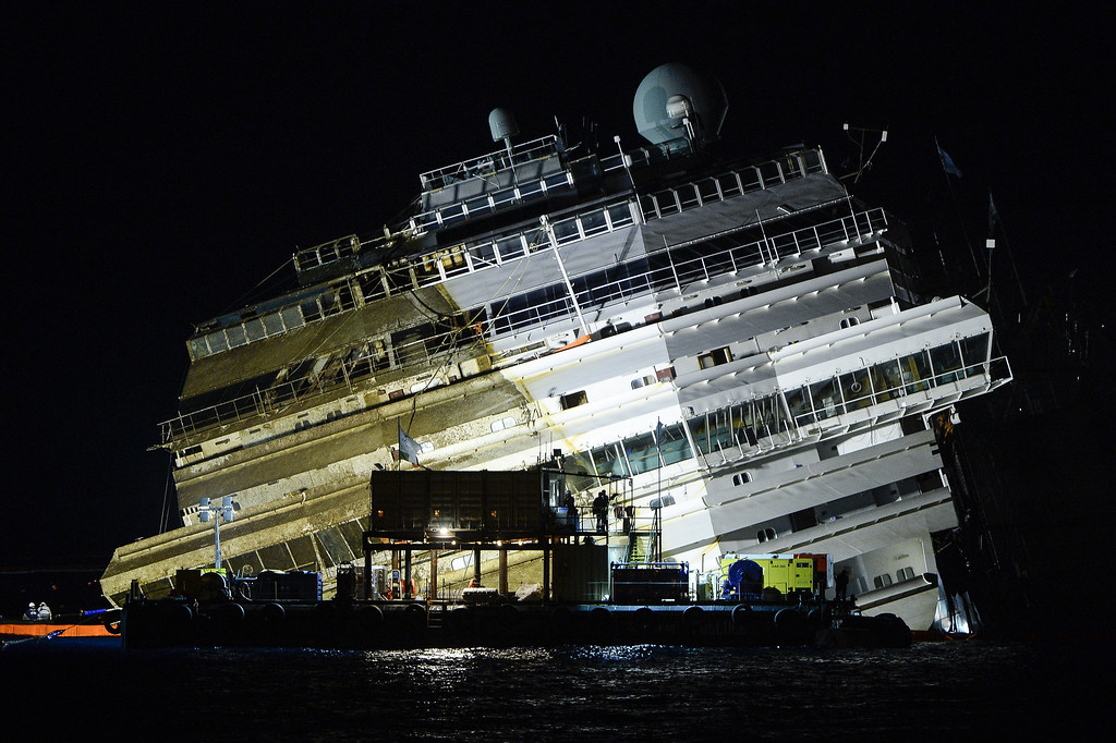 . The wreck of Italy\'s Costa Concordia cruise ship begins to emerge from water on September 17, 2013 near the harbour of Giglio Porto.  ANDREAS SOLARO/AFP/Getty Images