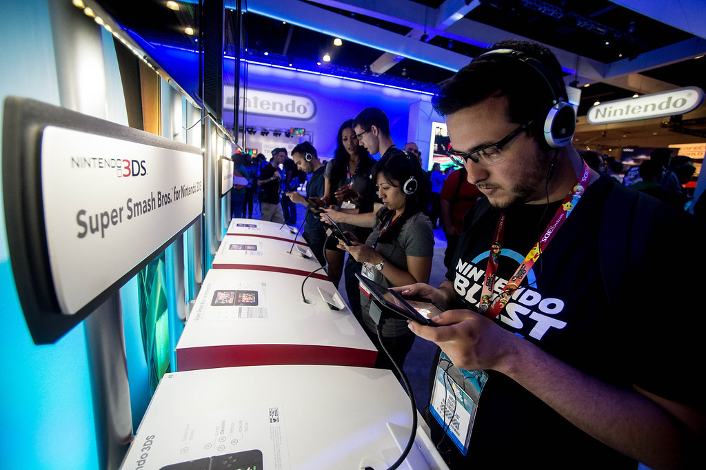 ". Attendees play the ""Super Smash Bros\"" video game on the Nintendo 3DS at at the Electronic Entertainment Expo in Los Angeles on Tuesday, June 10, 2014. (Photo by Watchara Phomicinda)"