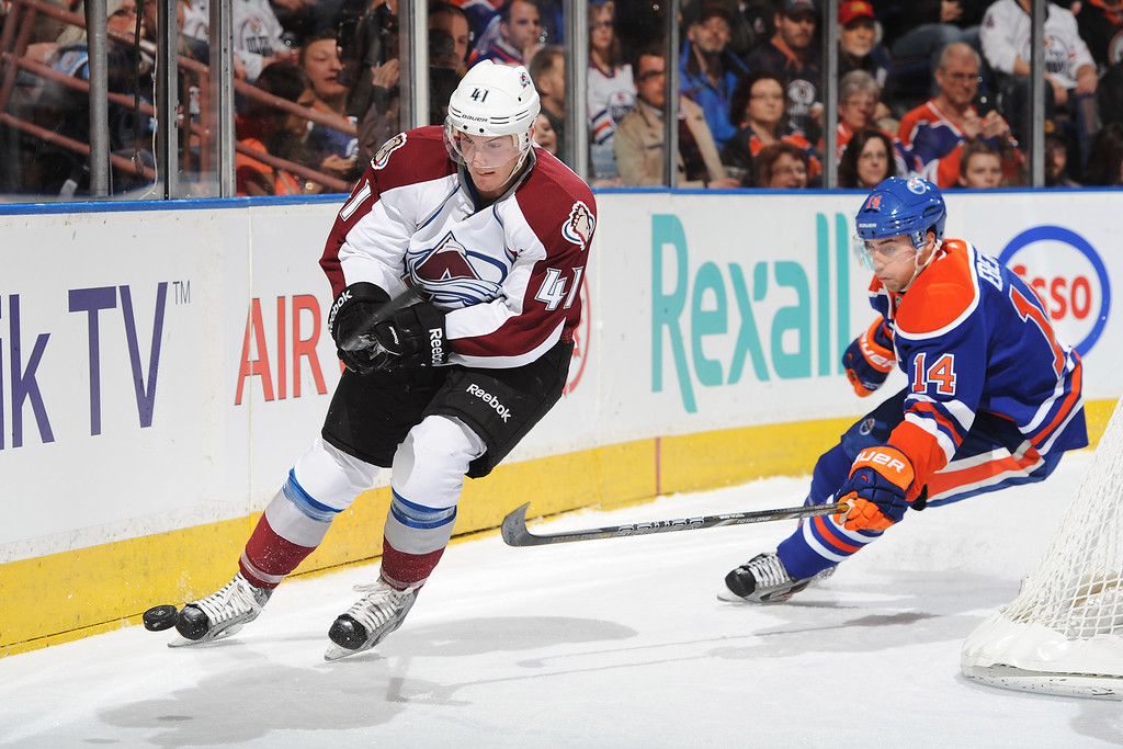 . EDMONTON, CANADA - FEBRUARY 16: Tyson Barrie #41 of the Colorado Avalanche skates with the puck against Jordan Eberle #14 of the Edmonton Oilers during the NHL game at Rexall Place on February 16, 2013 in Edmonton, Alberta, Canada. (Photo by Derek Leung/Getty Images)