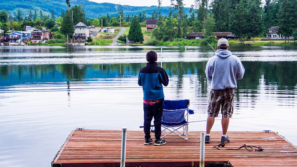Joe and Ozzy fishing from the dock