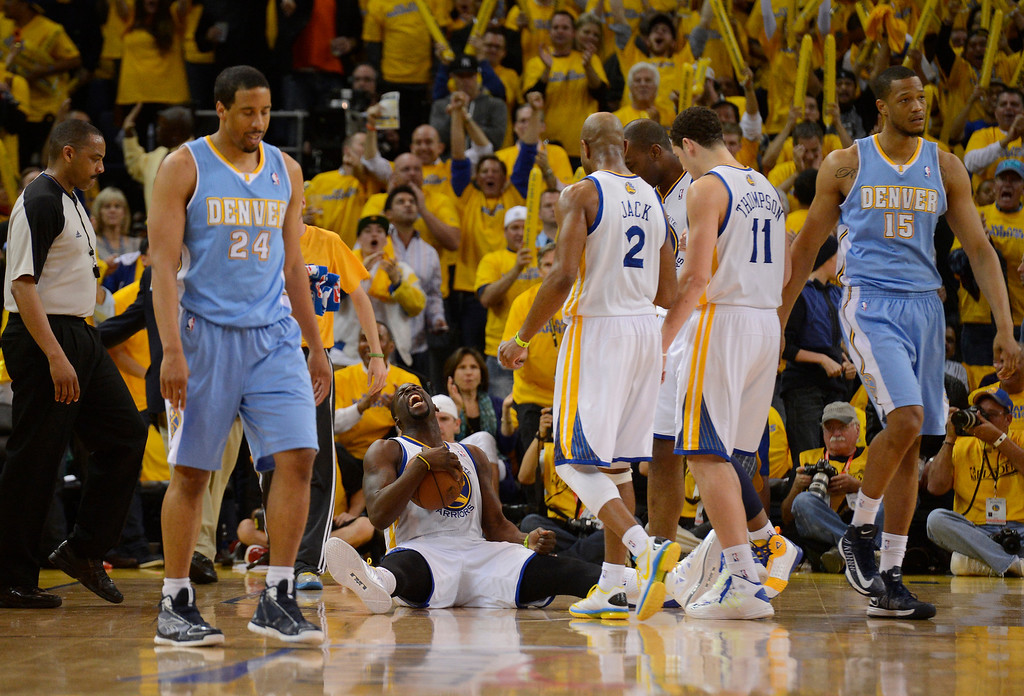 . OAKLAND, CA. - APRIL 26: Andre Miller (24) of the Denver Nuggets walks back off dejected after losing the ball to a jubilant Draymond Green (23) of the Golden State Warriors as he screams out load late in the third quarter in game 3 of the first round of the NBA Playoffs April 26, 2013 at Oracle Arena.  (Photo By John Leyba/The Denver Post)