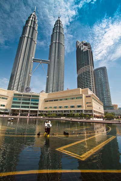Urban landscape/life scene at the Petronas Towers. What a splendid reflection there!